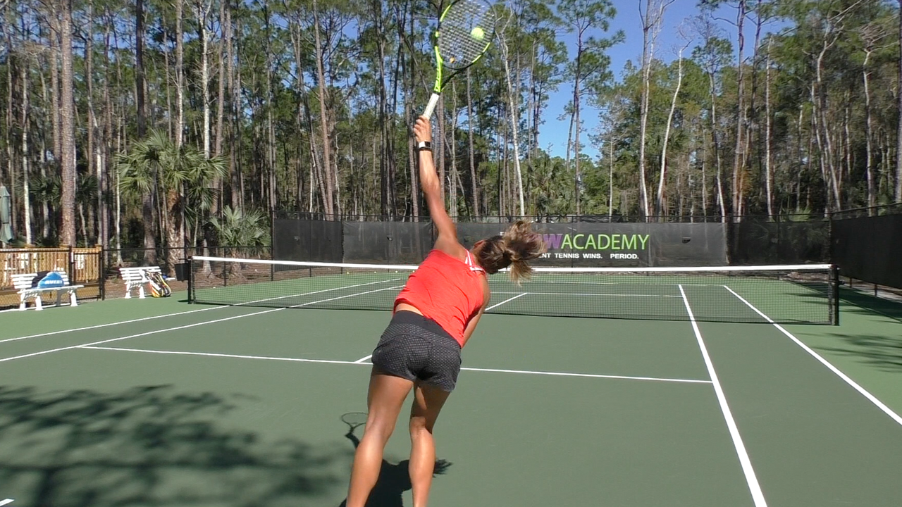 how to improve your serve - stop hitting balls intot the net